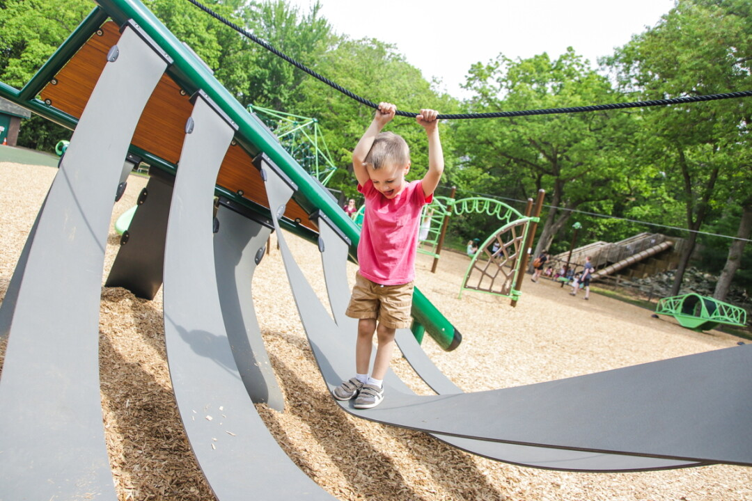 THE SWEET SOUNDS OF CHILDHOOD. The new $480,000 playground at Eau Claire's Carson Park features equipment designed for children with a wide range of ages and abilities, including children with physical handicaps.